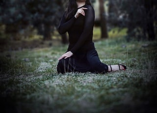shallow focus photo of woman in black long-sleeved shirt