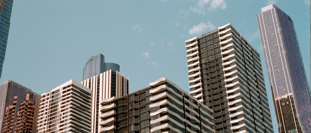 low-angle photo of buildings under blue sky