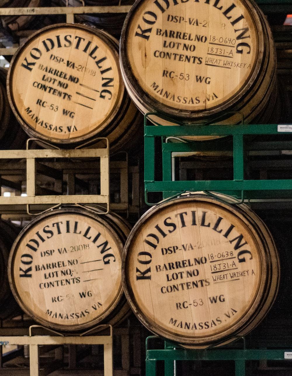 four brown Kodistilling wine barrels