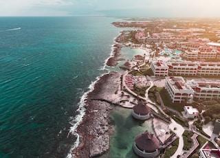 aerial view of hotels and resort facing ocean