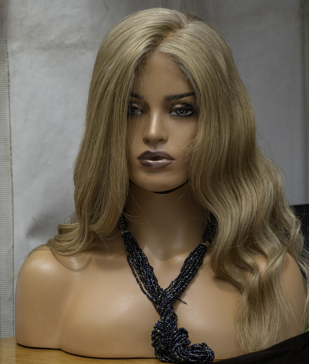 woman wearing necklace bust on brown surface