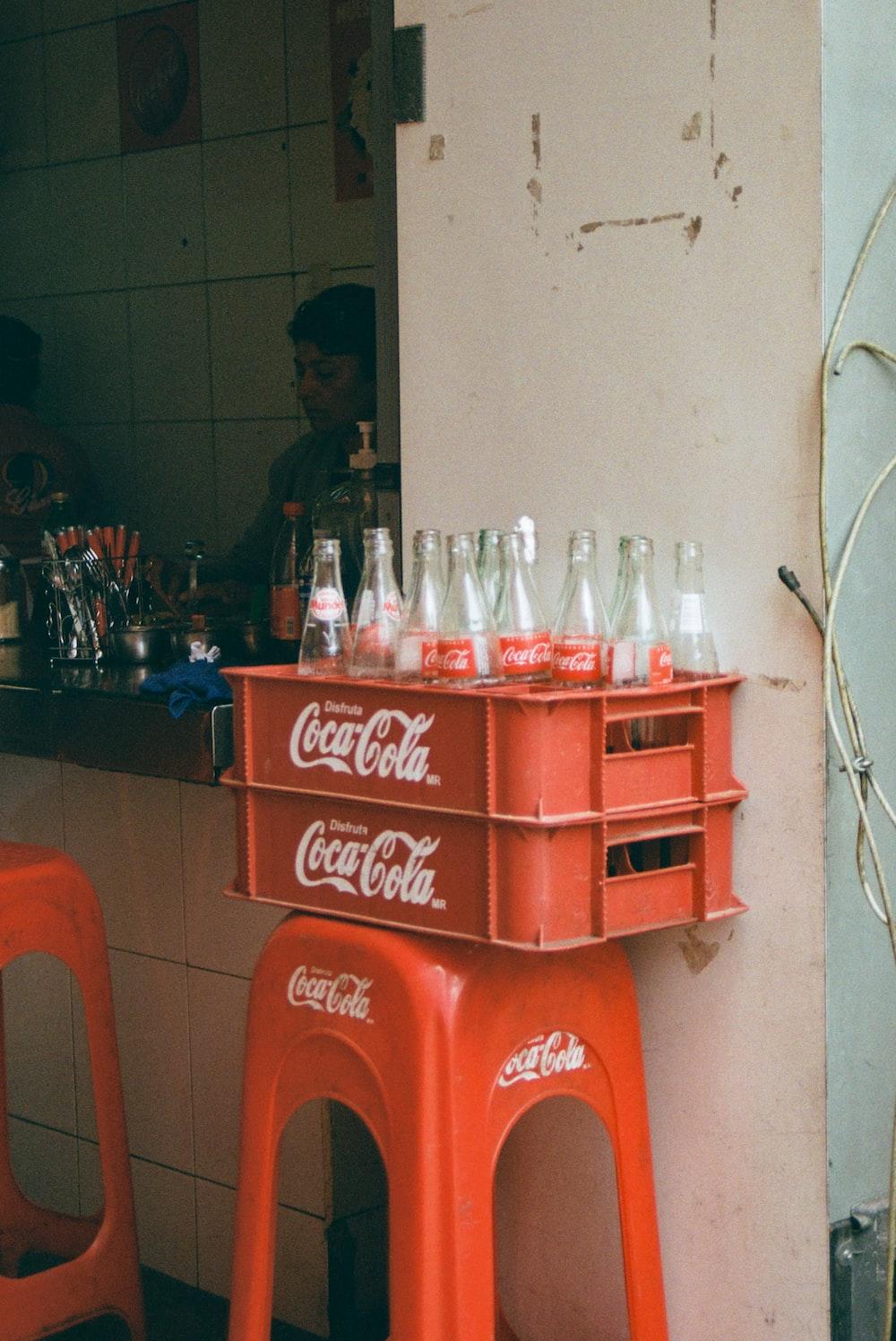 empty Coca-Cola bottles on crates