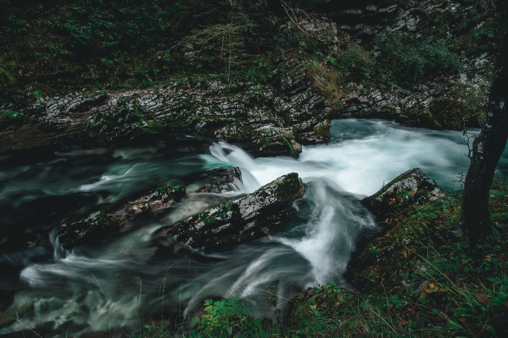 water flowing on rocks