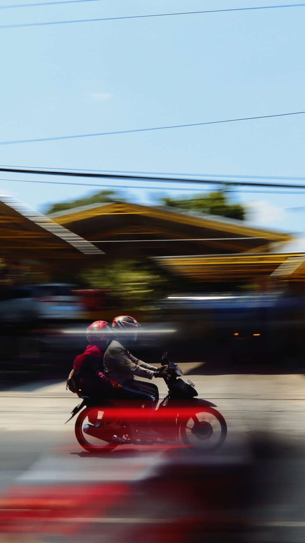 two people riding on motorcycle