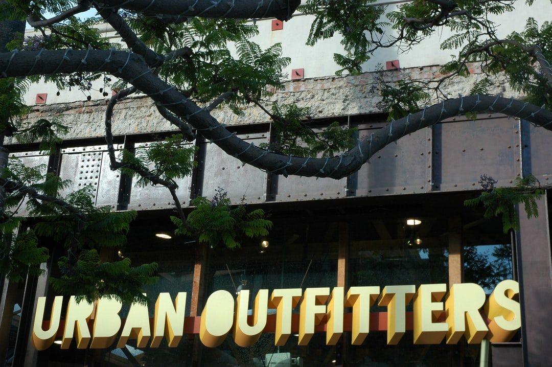 Urban Outfitters sign, industrial metal facade, tree branch wrapped, Santa Monica, California, USA