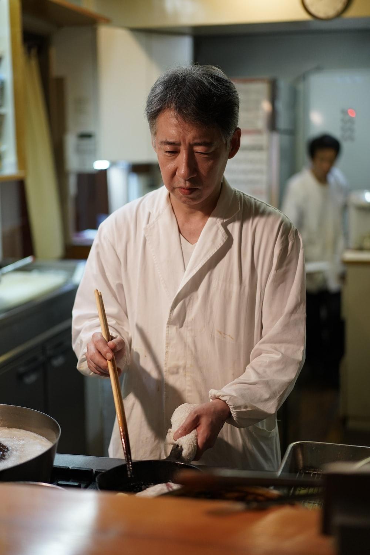 man cooking inside building