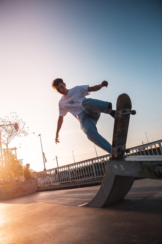 man playing skateboard on ramp