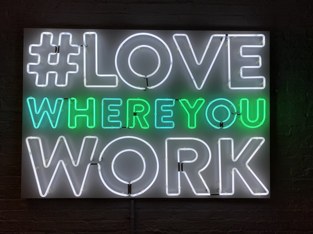 turned-on love where you work neon signage