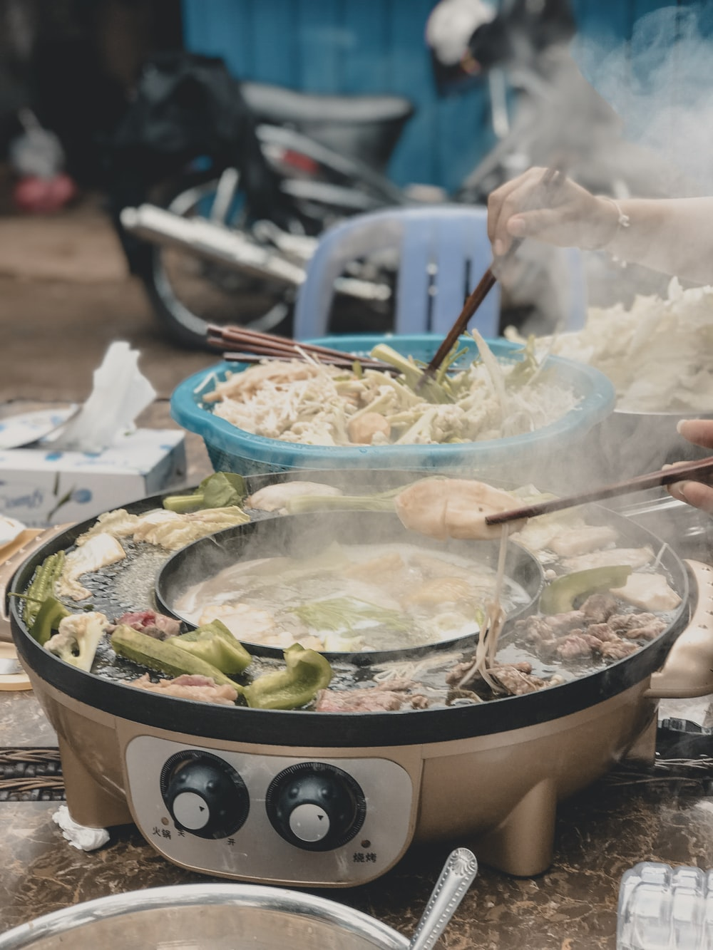 person cooking vegetables