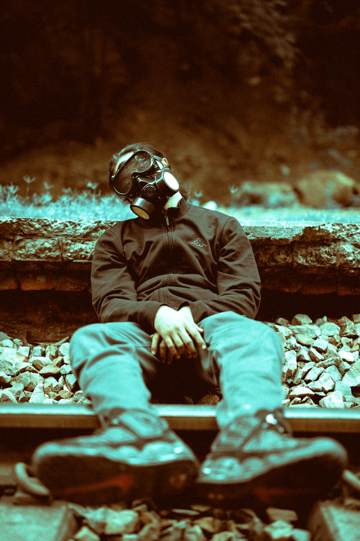 person lying on train rails