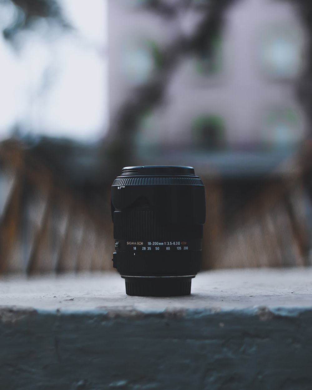selective focus photography of camera zoom lens on ground