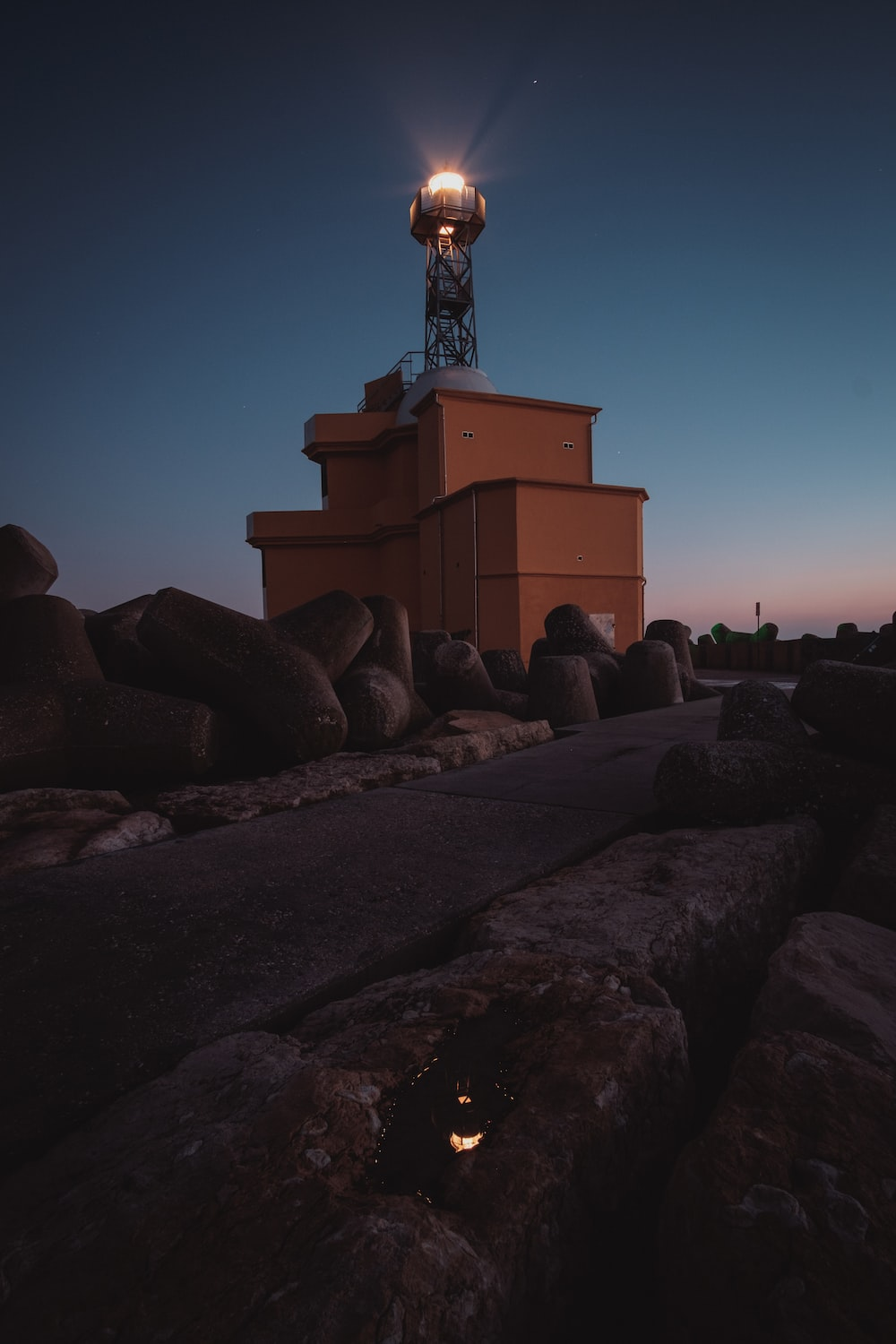 brown concrete lighthouse at night