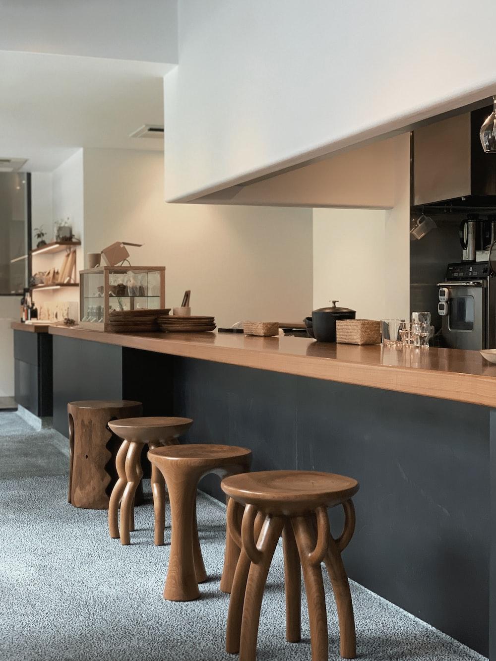 empty brown wooden stools