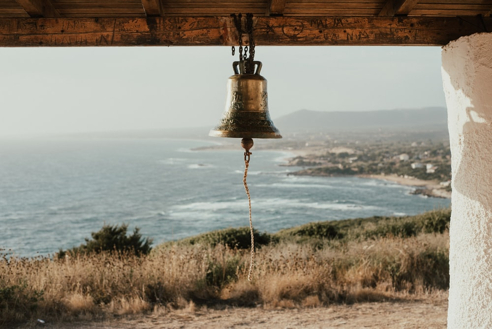 brass-colored bell