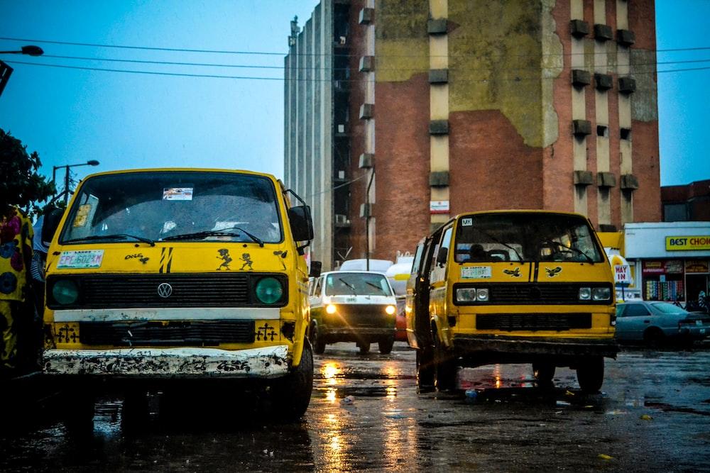 yellow vehicles during daytime