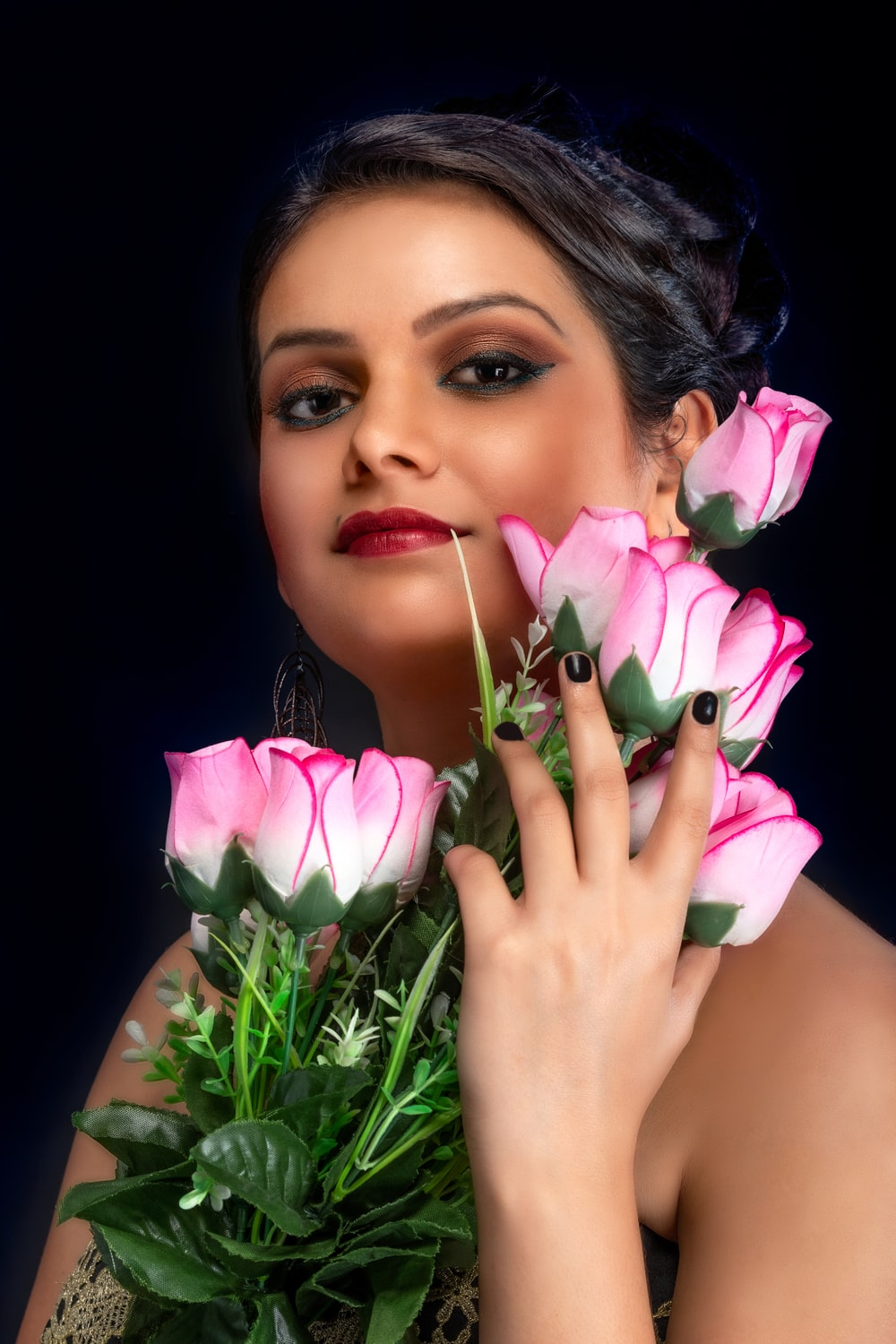 woman holding pink rose flowers