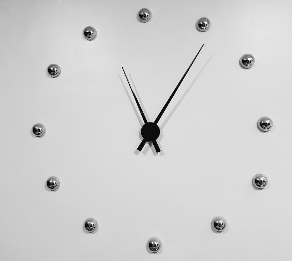 black and silver analog clock displaying 11:06 time