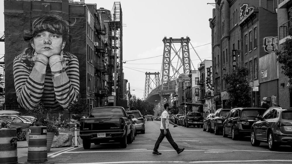 greyscale photography of man walking