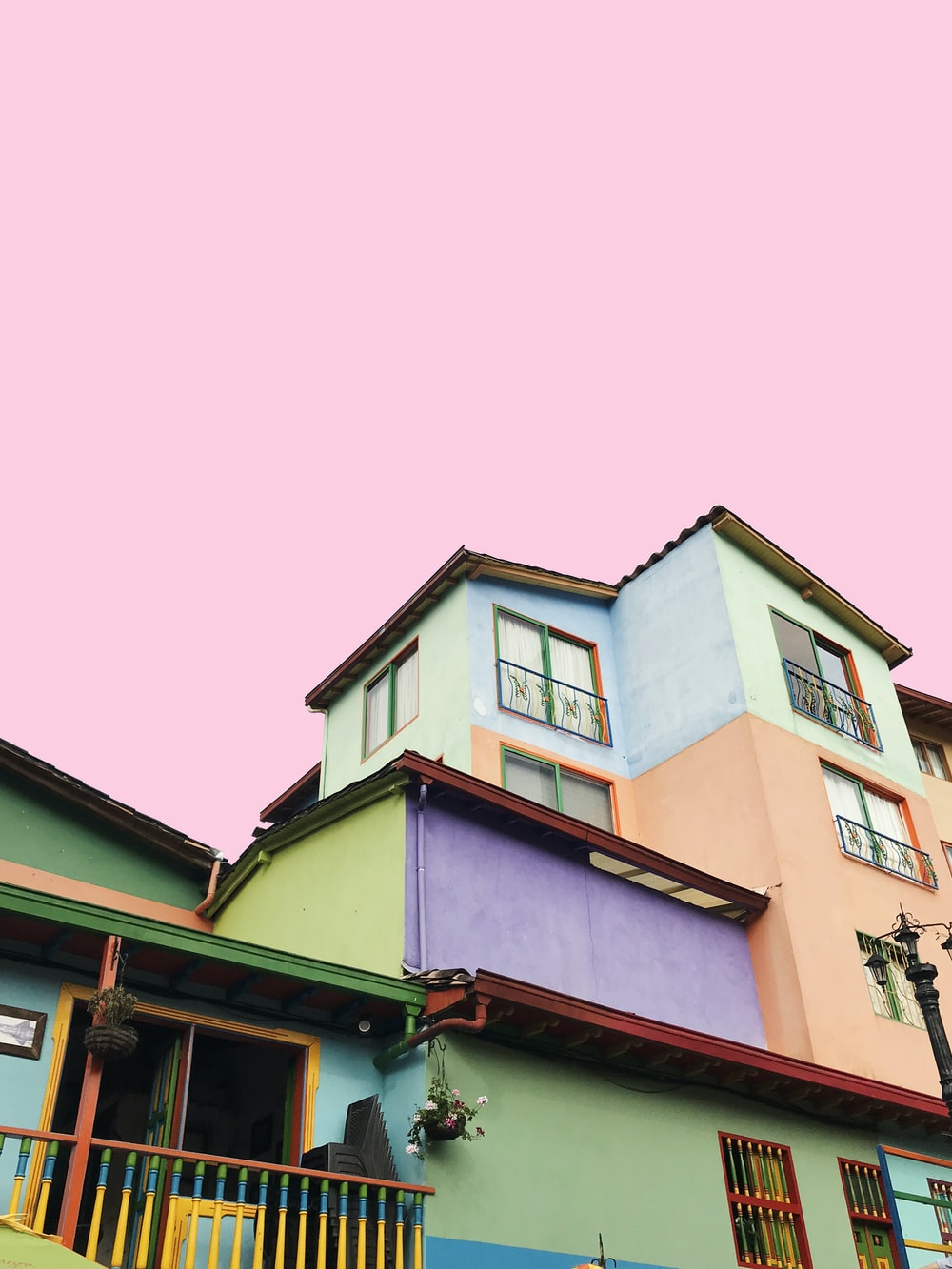 multicolored house under pink sky