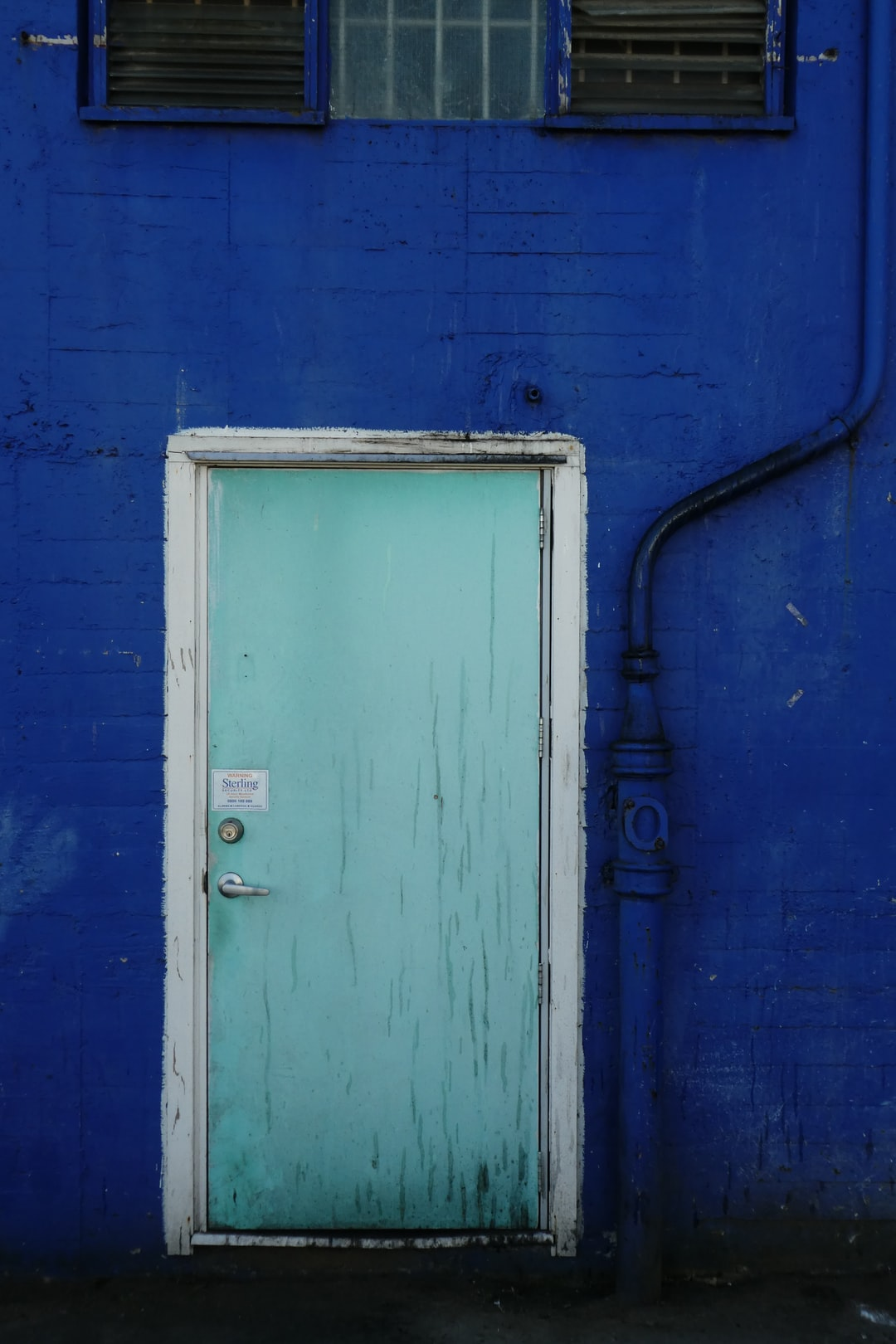 the blue door and blue wall.
