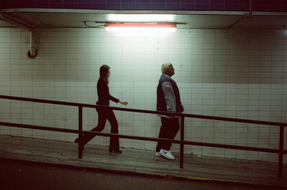 man and woman walking on basement