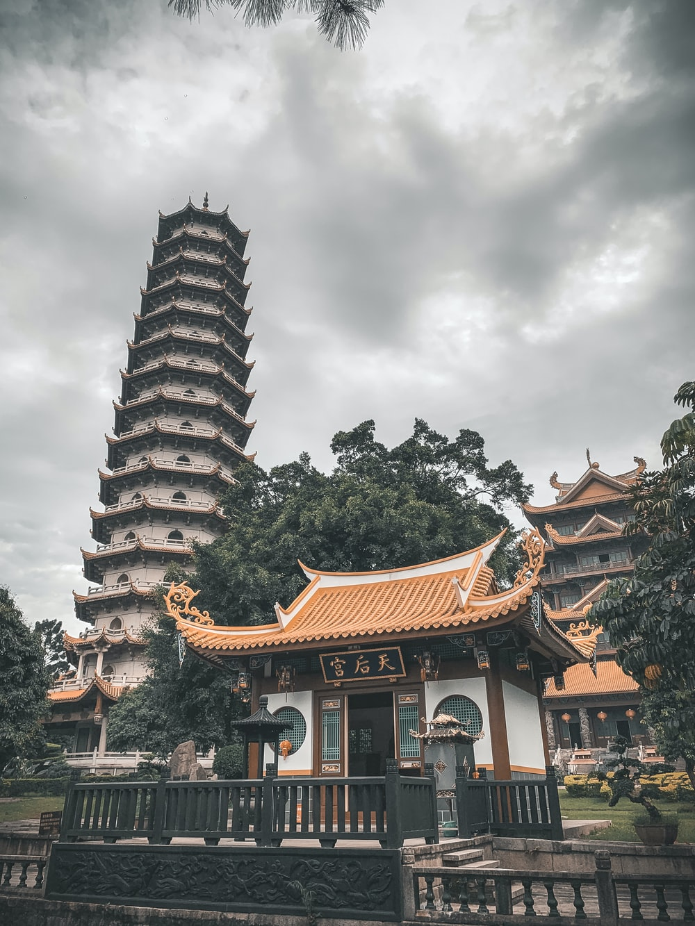 orange and white temple under white and gray sky