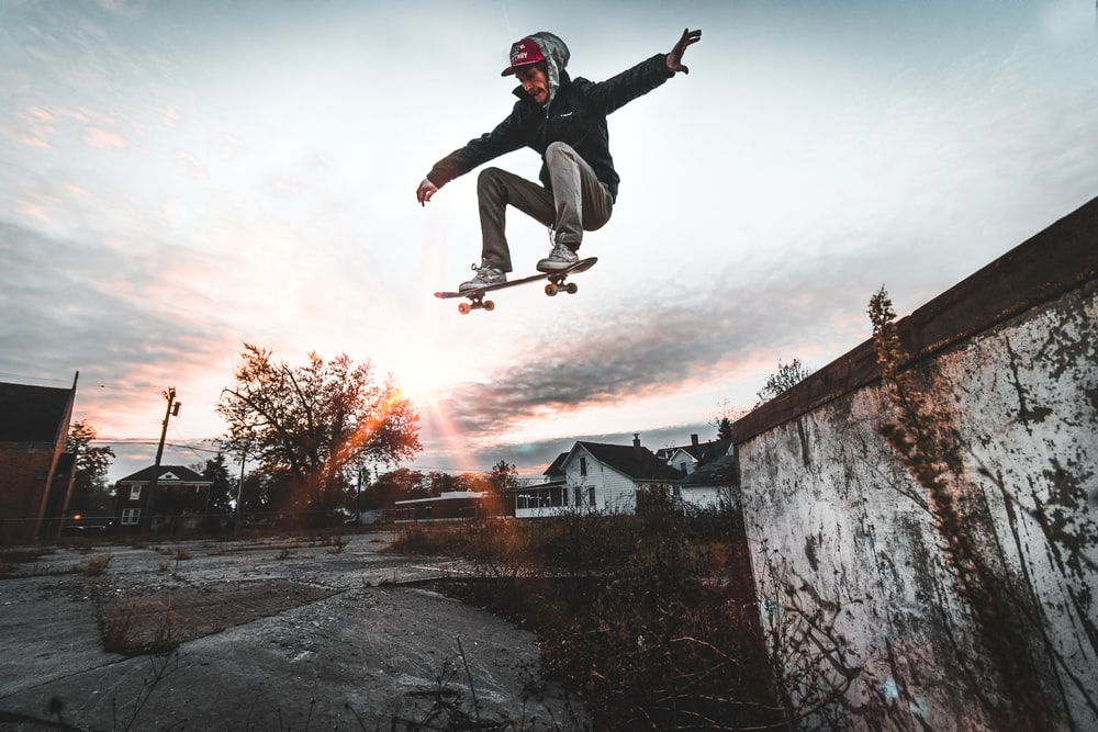 man jumping with skateboard