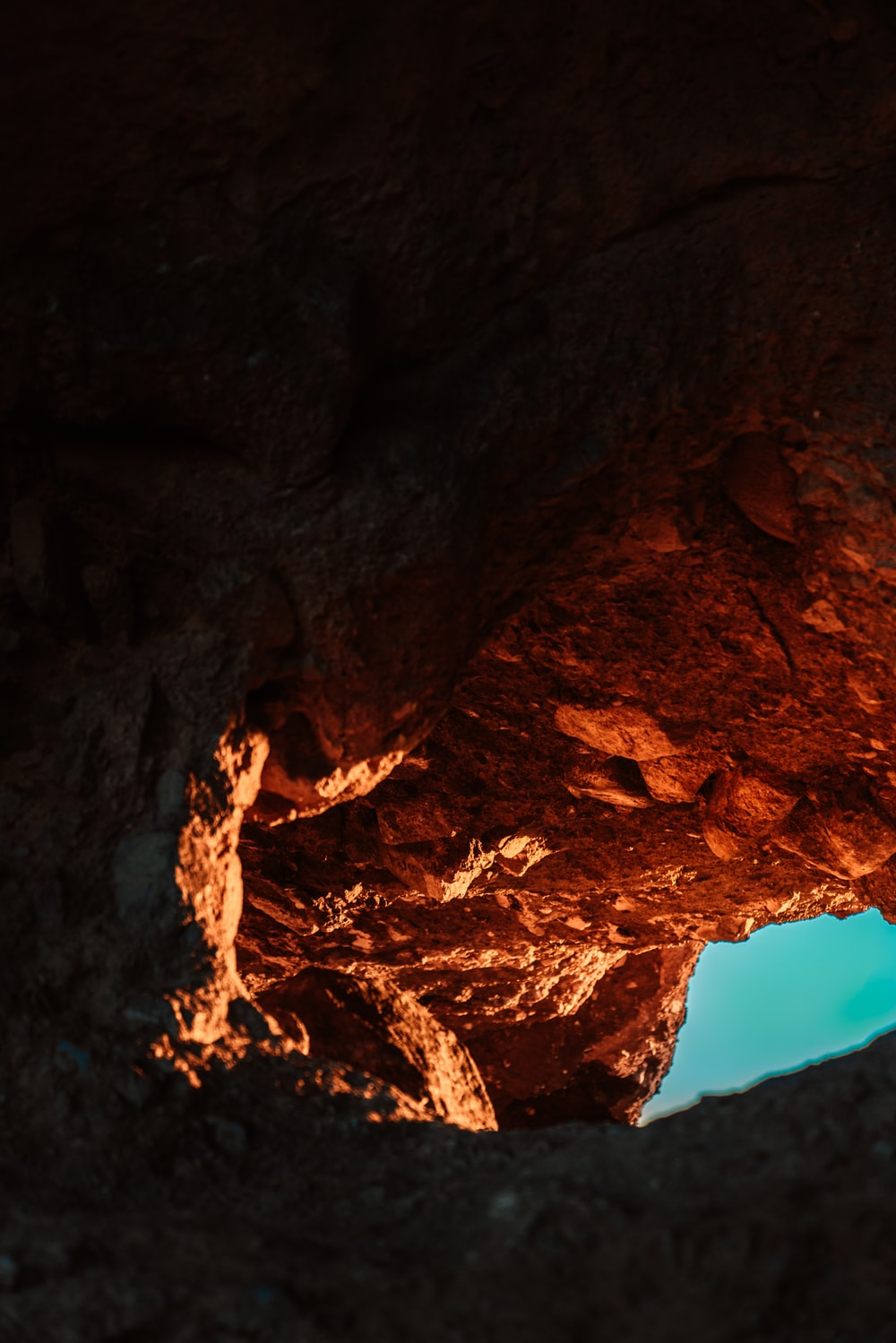 rocky cave during day