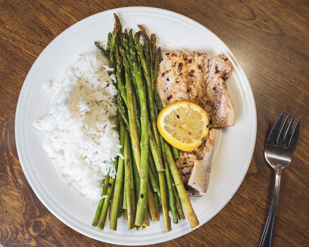 plate of asparagus beside fork