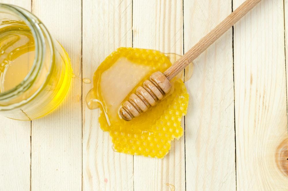 honey dipper on honey comb