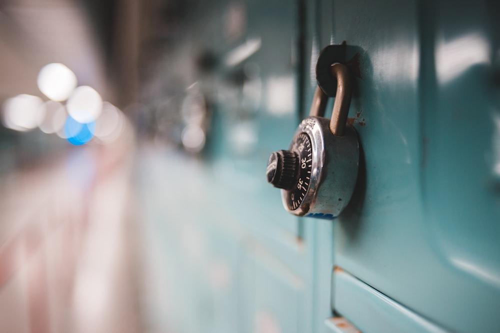 selective focus photography of gray metal padlock