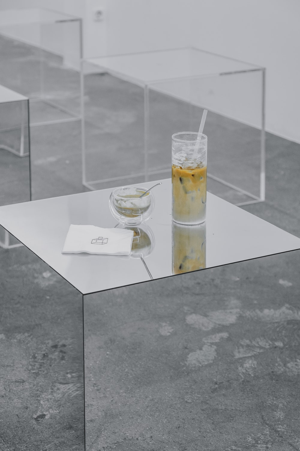 half-filled clear drinking glass with straw