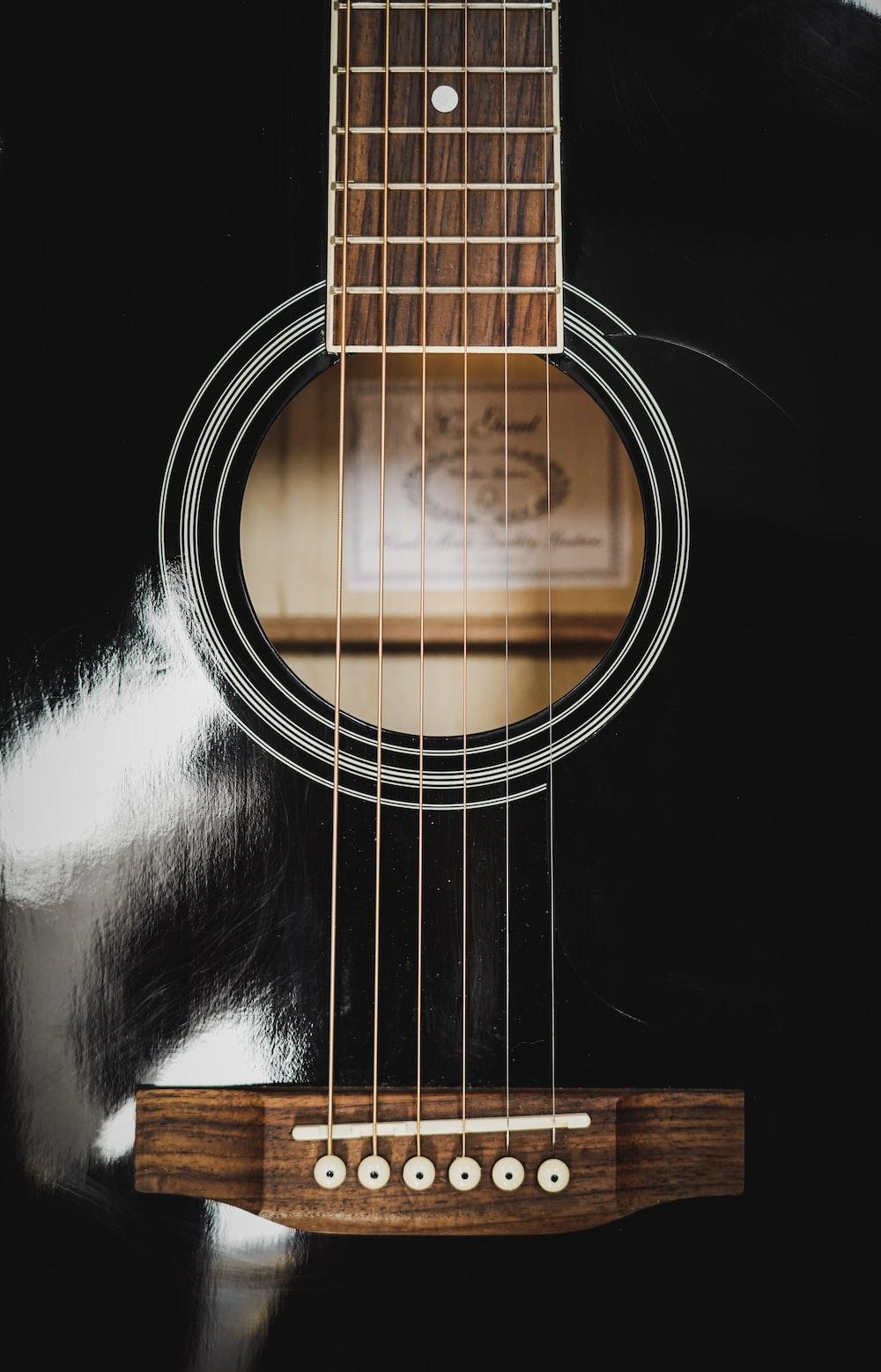 black and brown guitar