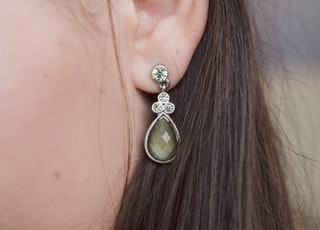 woman silver-colored earring