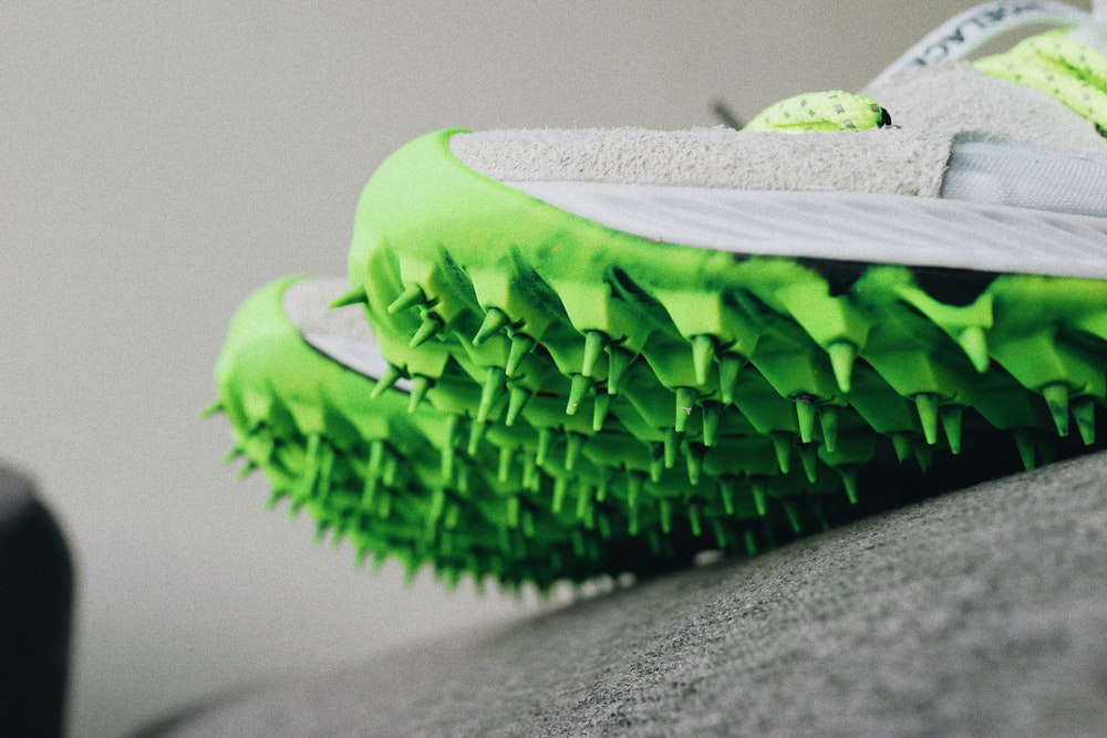 pair of white-and-green cleats
