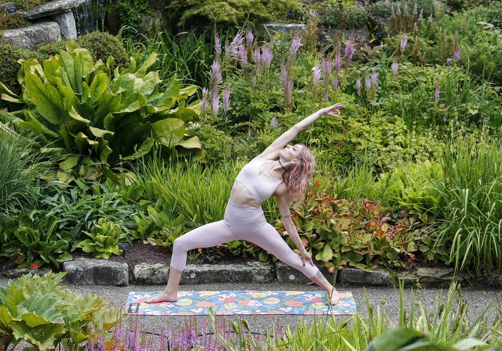 woman doing yoga during daytime