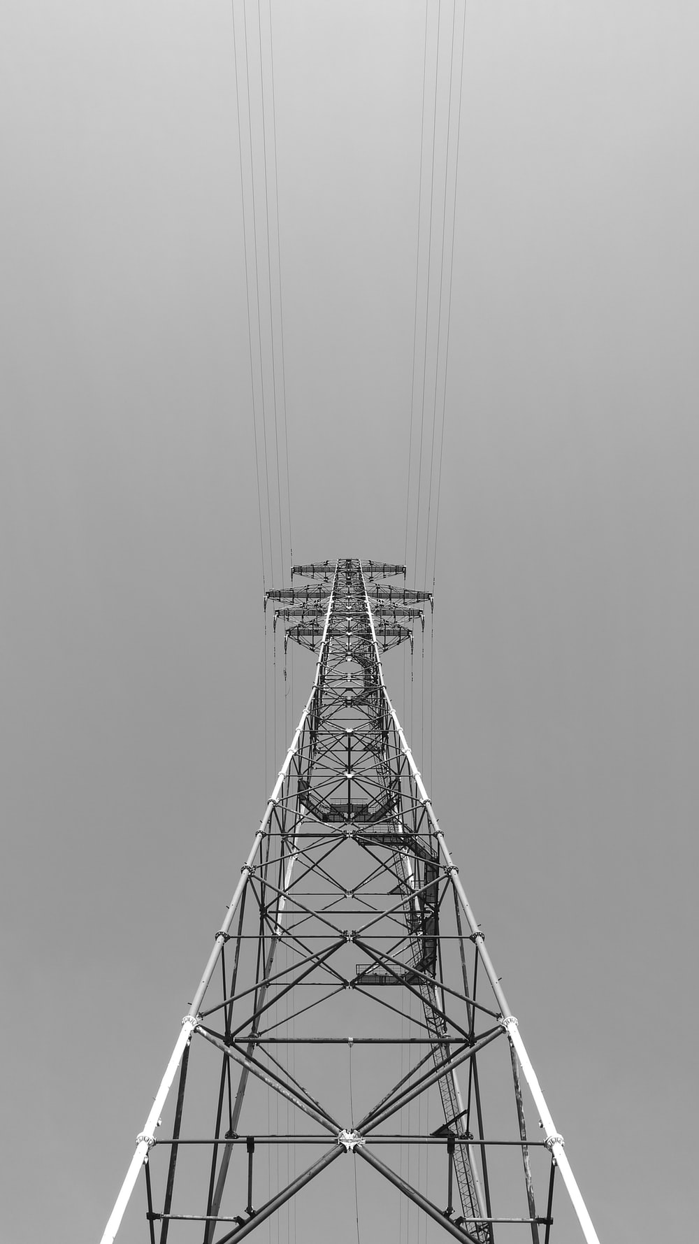 greyscale photography of metal tower