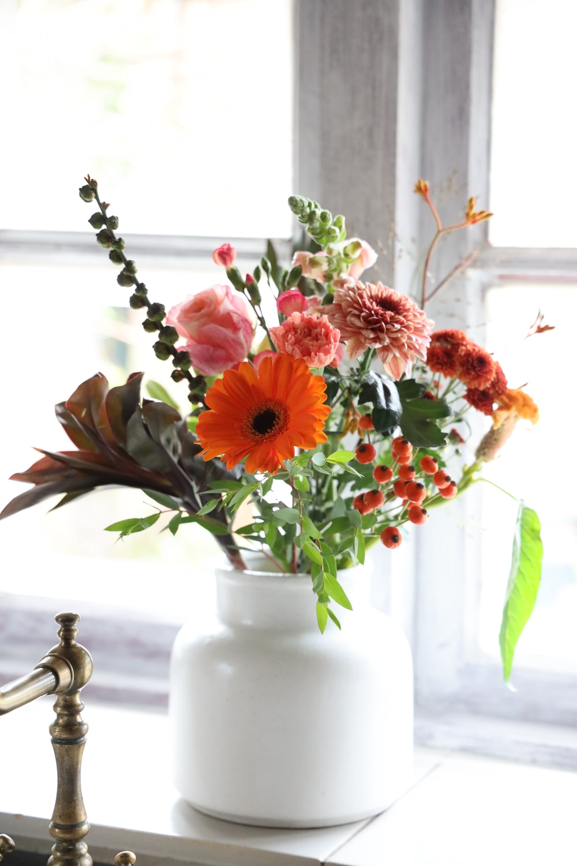flower arrangement in vase on window