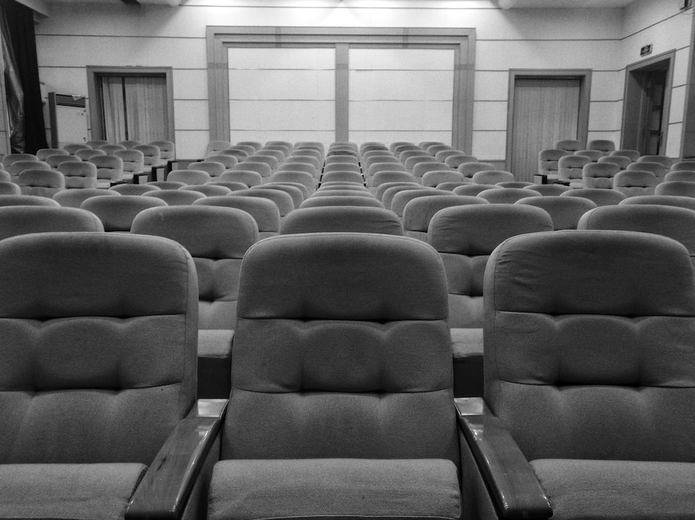 greyscale photo of theater seats