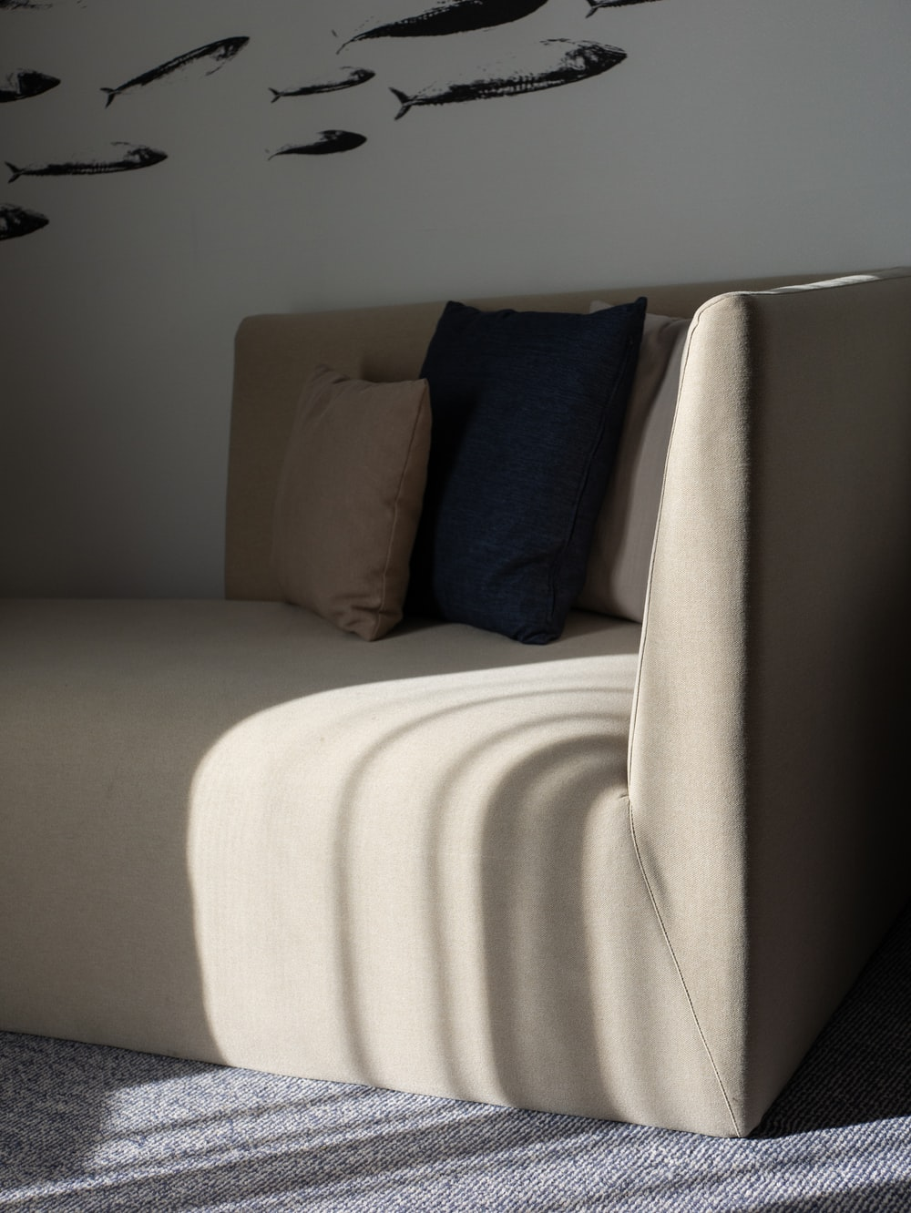 square white and black throw pillows on white fabric couch