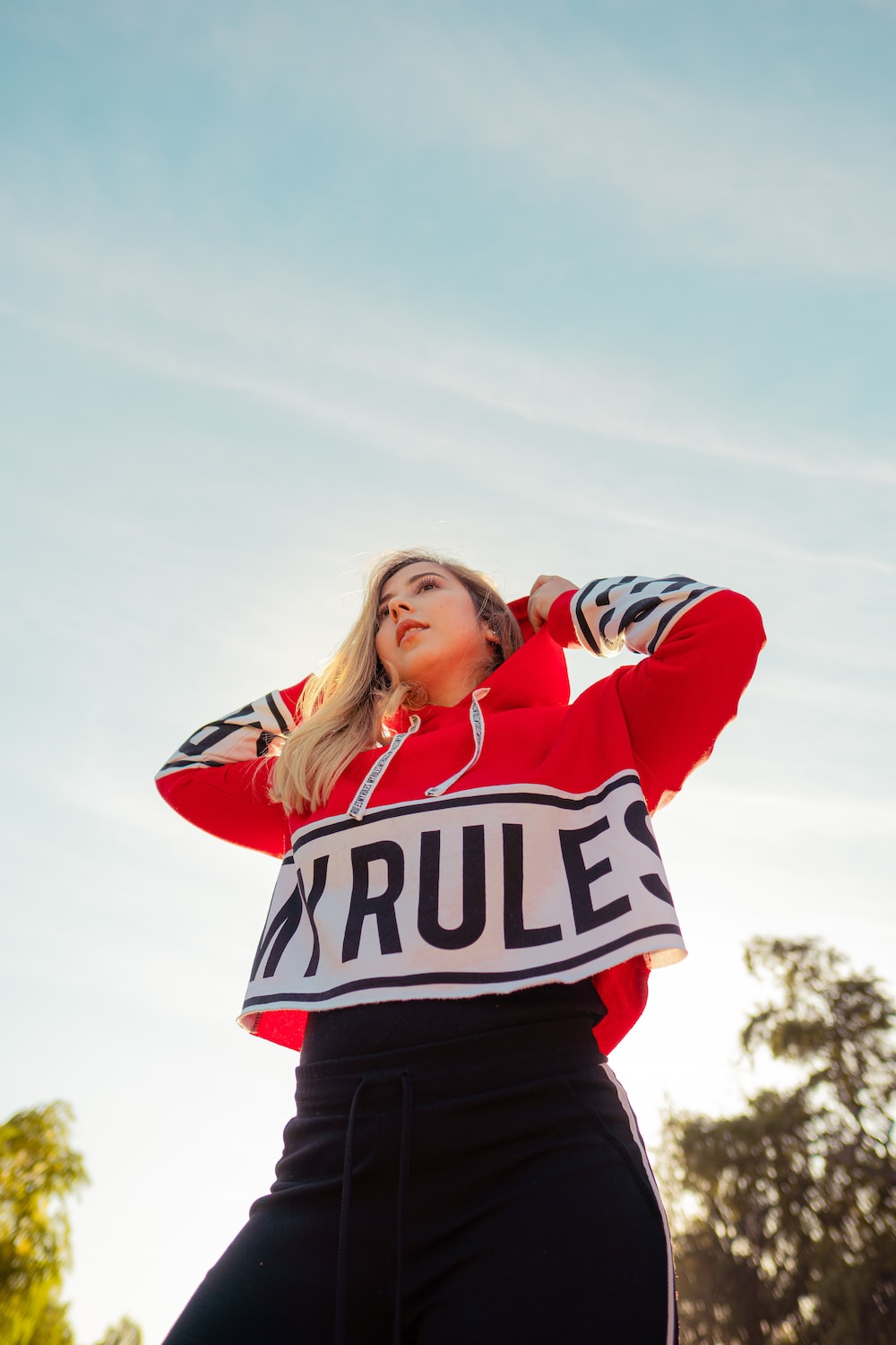 shallow focus photo of woman in red and white pullover hoodie