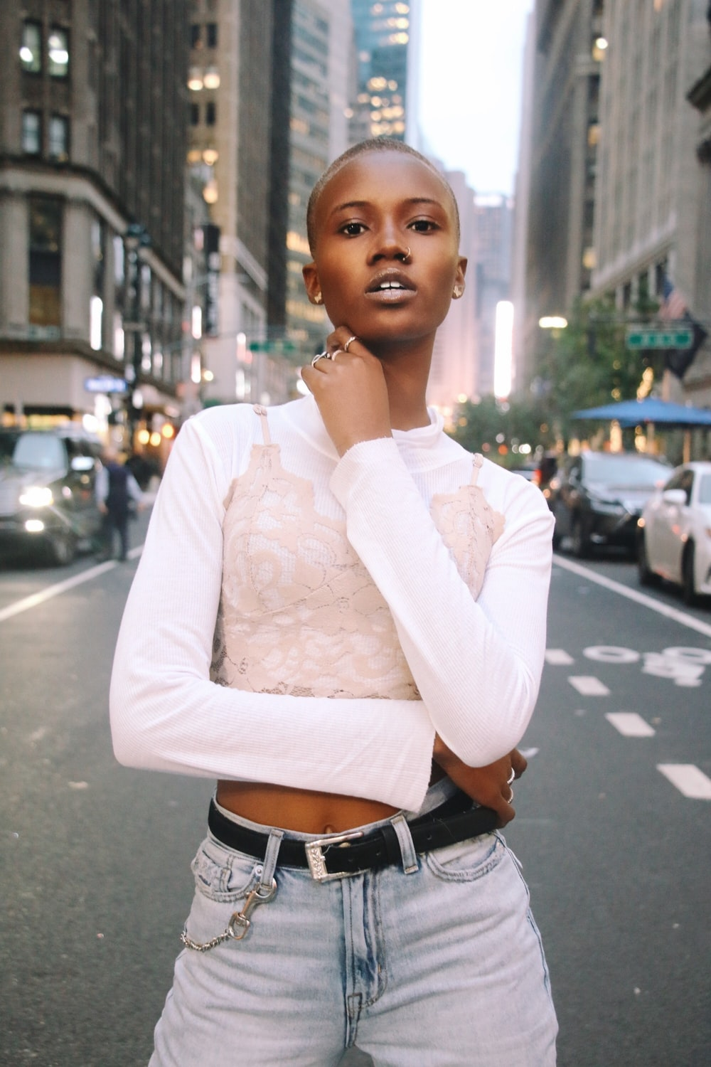shallow focus photo of woman in white long-sleeved crop top