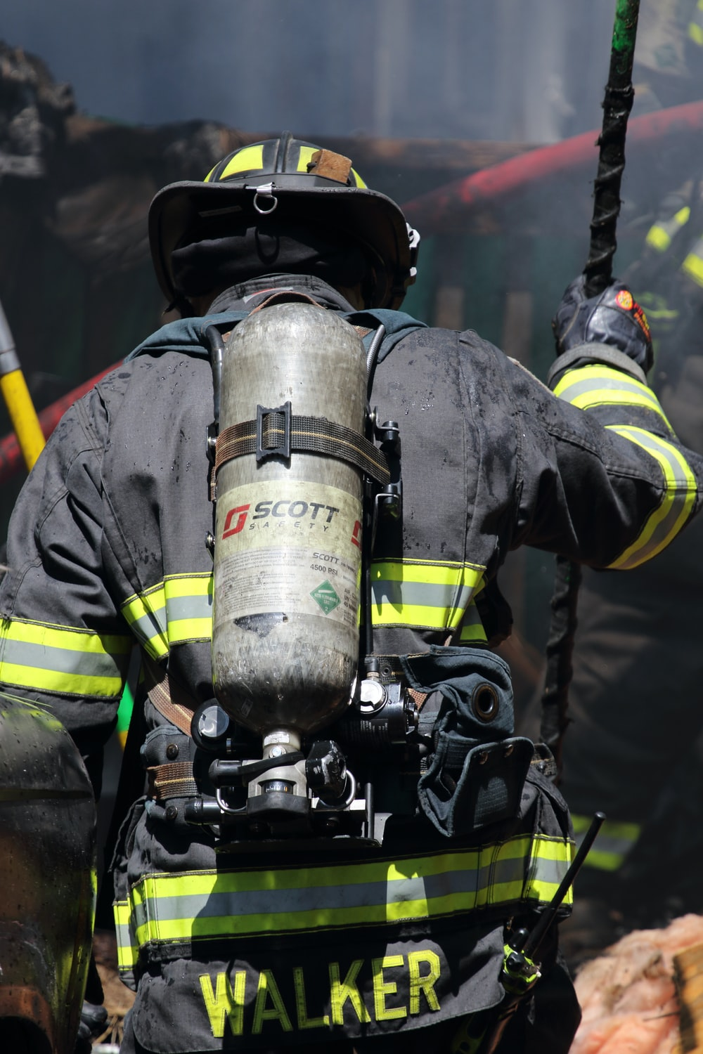 shallow focus photo of firefighter