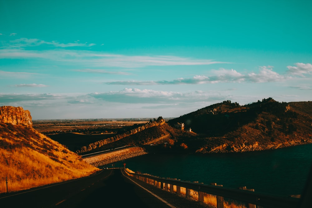 view photography of road under blue sky