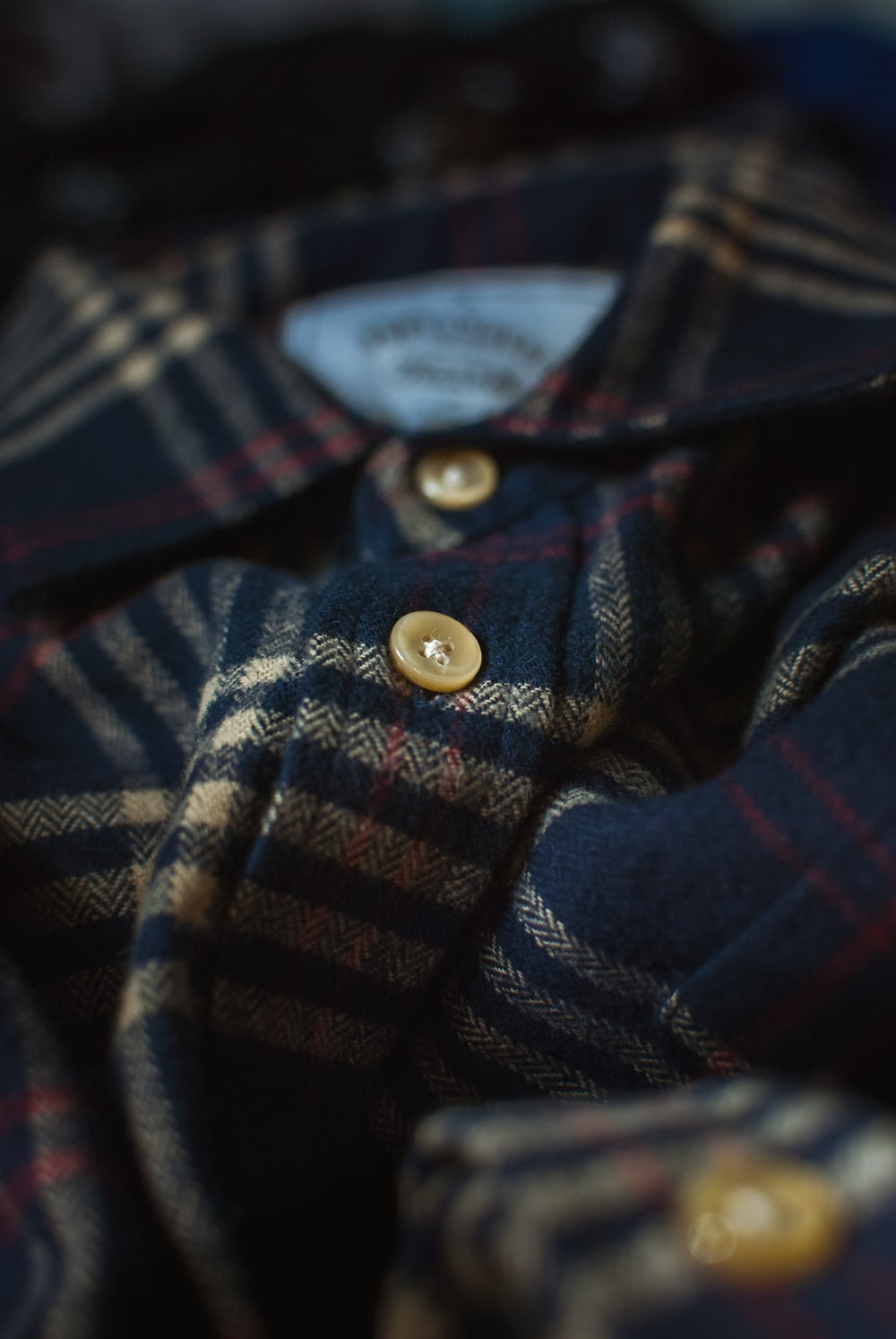 black, gray, and red plaid collared shirt