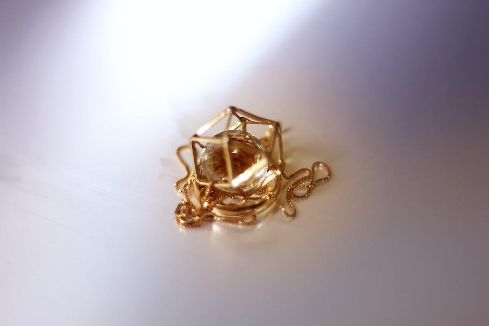 round gold-colored pendant