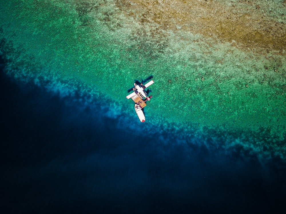 aerial photography of plane on sea