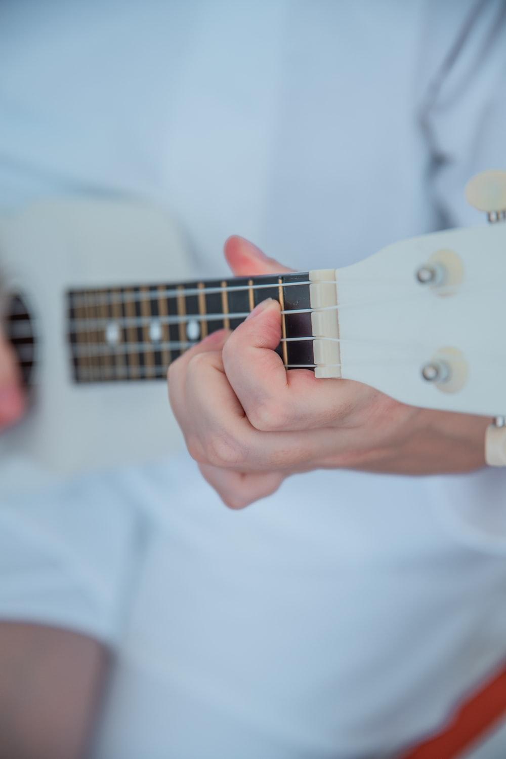 person playing ukulele