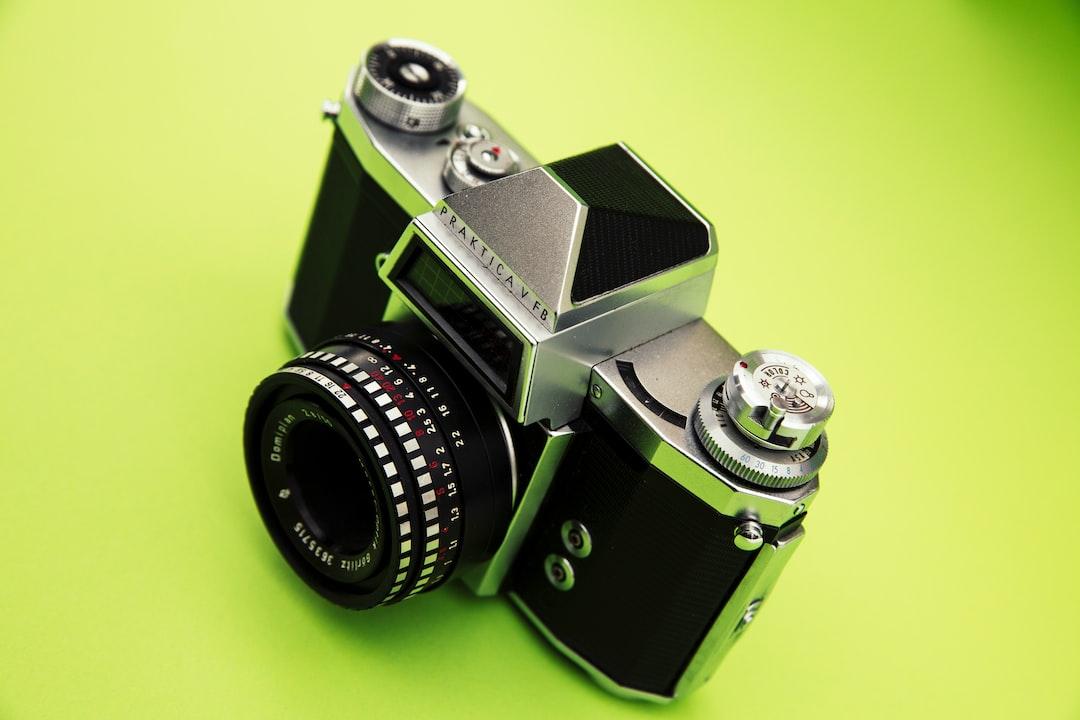 Analog 35mm vintage photo camera - Praktica V FB with Meyer Optik Görlitz lens Domiplan f2.8 50mm