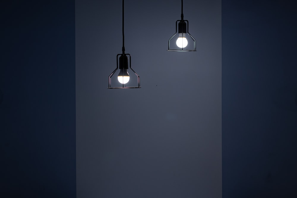 two turned on pendant lamps